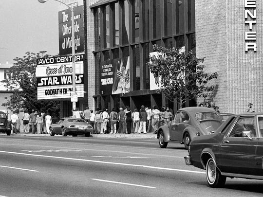 """Fans wait in line at the Avco Center Theater in Los Angeles on June 7, 1977, to see """"Star Wars."""""""