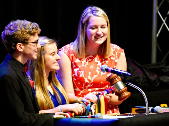 2017 PASC State President Gianna Dovell, center, and Conference Co-chairs Jacob (Norman) Franciscus, left, and Emilee Cutler bang the gavel, officially calling the conference to order as Red Lion Area High School hosts the 81st Annual PASC State Conference at the high school in Red Lion, Thursday, Nov. 2, 2017. Dawn J. Sagert photo