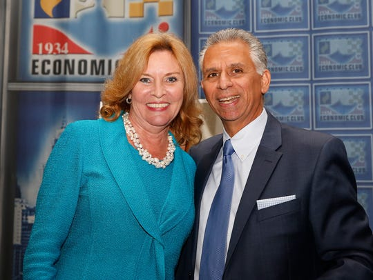 Beth Chappell, outgoing president and CEO of the Detroit Economic Club, with Steve Grigorian, incoming president and CEO, at her farewell reception held Dec. 17, 2017, in Detroit.