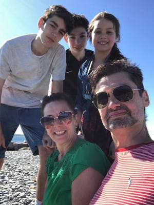 Dr. Daniel Sousa, a physician with Southcoast Health Pulmonary, enjoys a day at the beach with his family, sons Sidney, 14, and Skiler, 12, and daughter Scarlet, 8, and his wife, Theresa.