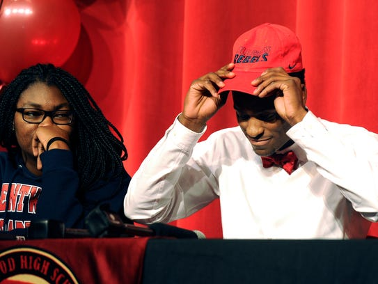 With his sister Faith by his side, Ravenwood football player Van Jefferson announces he will be playing for Ole Miss during a signing day ceremony in 2015.