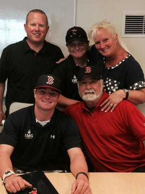 Logan Allen with his family and Boston's Stephen Hargett.