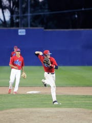 4-C shortstop Cody McGaha fields the ball and throws to first base on Saturday at Ricketts Park.