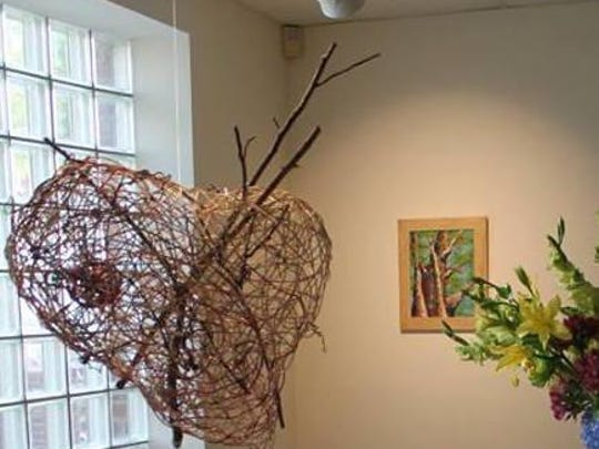 Libby Lynch received an honorable mention for her woven piece 'Heart and Tree' at the Tennessee Arts Academy.