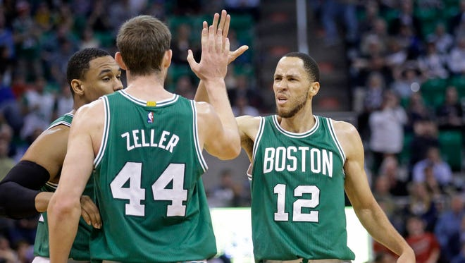 Boston Celtics' Tayshaun Prince high-fives Tyler Zeller  on Jan. 26, 2015. Prince was traded to the Pistons on Thursday.