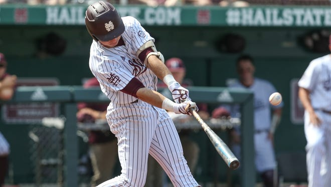 Mississippi State's Brent Rooker (19) hits a home run in a recent game.