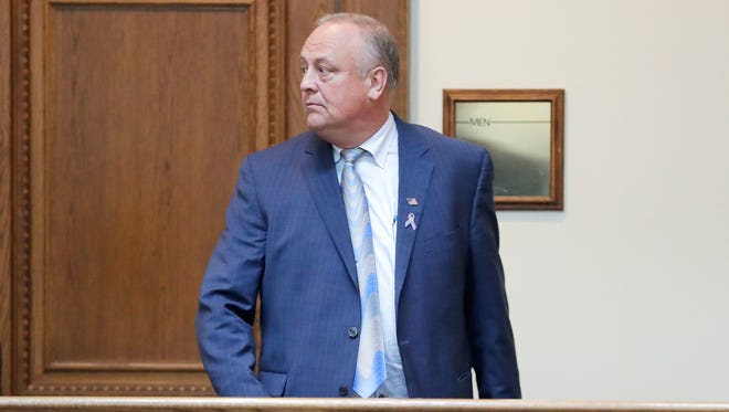 De Pere businessman Ron Van Den Heuvel leaves court after a plea agreement hearing Tuesday at U.S. District Court in Green Bay.
