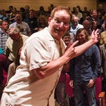 """""""Whad'Ya Know?"""" host Michael Feldman celebrates with the audience of his long-running show in Madison."""