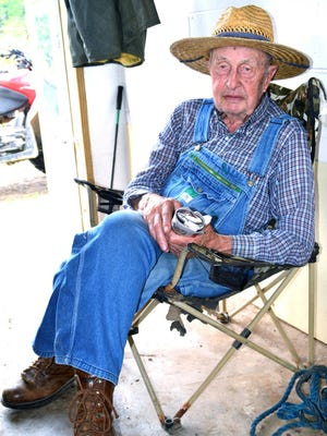 In this photo taken May 17, 2017, Ray Seaton, who will turn 93 in August, sits at his family's Debusk, Tenn., dairy farm. Seaton began working on his father's farm in 1931.