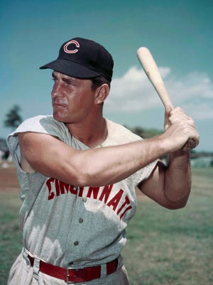 """FILE - This March 1957 file photo shows Cincinnati Reds infielder Ted Kluszewski. Years before he journeyed to """"The Twilight Zone,"""" television writer Rod Serling made a brief detour to the strike zone, writing a comedy about baseball. The comedy is peppered full of references to Reds slugger Ted Kluszewski, Stan Musial, Willie Mays, Duke Snider and other stars of the day. (AP Photo/File)"""