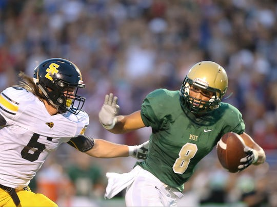 Iowa City West's Oliver Martin has been crucial to the Trojans' 2-0 start so far in 2016.