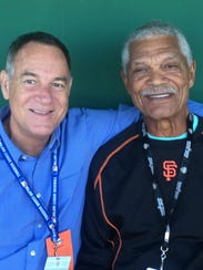 Felipe Alou, right, with biographer Peter Kerasotis.