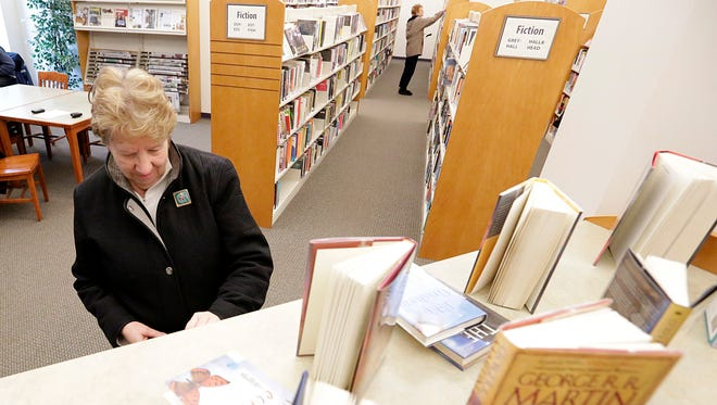 Pam Birschbach of Fond du Lac looks at new books at the Fond du Lac Public Library.