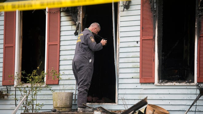 State Police fire marshall Terry Carberry investigates at scene of fire in Dover Township.