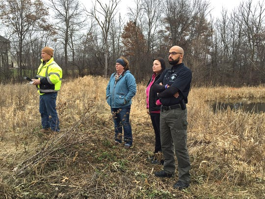 John Mitchell, right, and Deanna Villella, second from right, founders of United Legacy Search, Rescue and Recovery, stand with two volunteers using a drone to search for Martise Windom Dec. 11 in Savage.