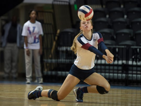 Montgomery Academy's Anne Carlson Sylvest (11) digs the ball during the AHSAA Class 3A State Volleyball Championship between Montgomery Academy and Bayside Academy on Thursday, Nov. 2, 2017, in Birmingham, Ala.