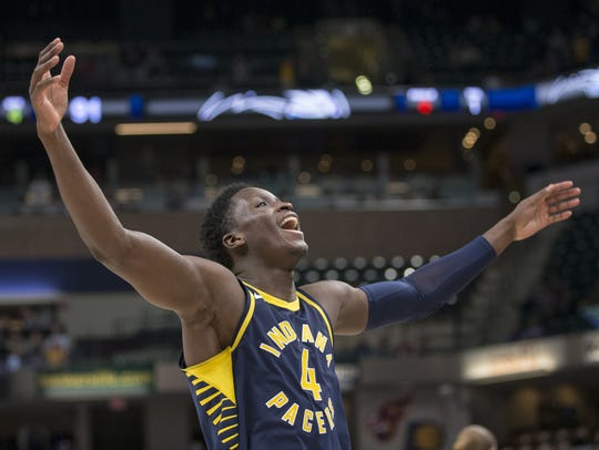 Victor Oladipo, who went 11 for 14,  celebrates near