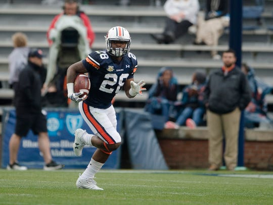 Auburn wide receiver JaTarvious Whitlow (28) runs downfield during the Auburn A-Day game on Saturday, April 7, 2018, in Auburn, Ala.
