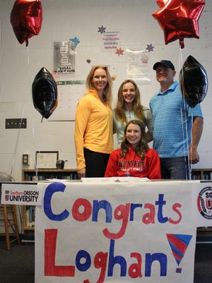 Kennedy senior Loghan Sprauer (seated) signed a letter of intent to compete in track and field at Southern Oregon on Thursday, Feb. 12.
