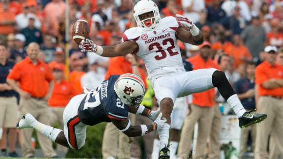 Auburn defensive back Robenson Therezie strips the ball from Arkansas running back Jonathan Williams during the first series of the second half of the SEC football game between Auburn and Arkansas at Jordan-Hare Stadium on Saturday.