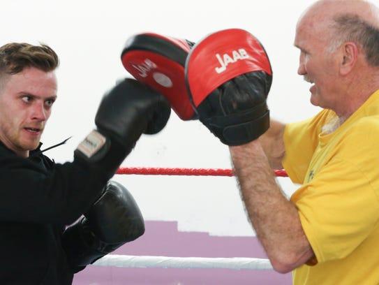 Boxer Ryan Douglas (left) works out with Joe Tiberi