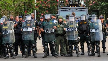 Baton Rouge police get ready to respond to protests July 11, 2016.