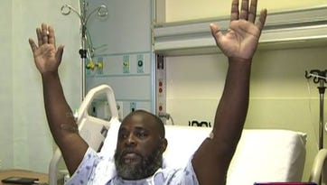 Charles Kinsey explains during an interview from his hospital bed on July 20, 2016, how he was holding his hands up when a North Miami police officer shot him in the leg. The Florida Department of Law Enforcement is investigating the shooting.