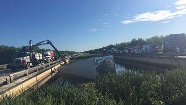 18-wheeler slams into water off I-10; driver dead