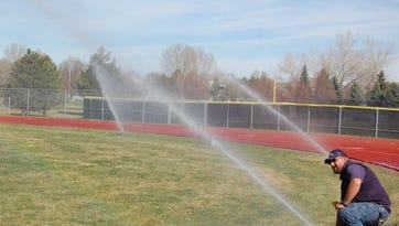 Poudre School District maintenance worker Adam Smith tests sprinklers at Fort Collins High School's football field. FCHS is slotted to receive an artificial turf field if the district can move forward with its $375 million bond.