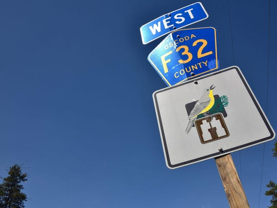 Signs along McKinley Road, Oscoda County Road F32 east