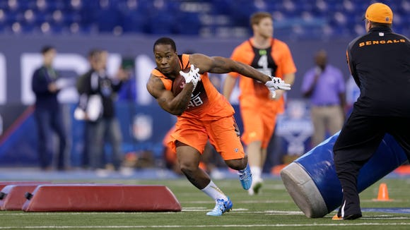 Auburn running back Cameron Artis-Payne runs a drill at the NFL football scouting combine in Indianapolis, Saturday, Feb. 21, 2015. (AP Photo/David J. Phillip)