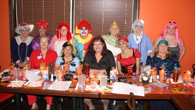 Members of the Red Hats Society in Deming gathered in festive costumes to celebrate Halloween at Yoya's Sports Bar and Grill. The women meet once a month at a different restaurant. The group is described as a fun-loving bunch who enjoy life and get to together to celebrate holidays, milestones and personal achievements.