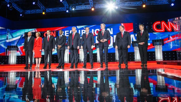 Ayla Brown (daughter of Gov. Scott Brown) sings national anthem during the final GOP Presidential Debate for 2015 held at The Venetian in Las Vegas, NV., on Dec.12, 2015. Candidate from L to R. John Kasich, Carly Fiorina, Marco Rubio, Ben Carson, Donald Trump, Ted Cruz, Jeb Bush, Chris Christie and Rand Paul.