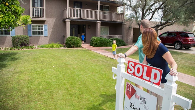 Phoenix homeowners could see the first property-tax increase in 20 years.  John and Charlotte Shaff watch as Jake Shaff closes the front door and Eric plays at their new home in Phoenix, AZ on April 11, 2015.