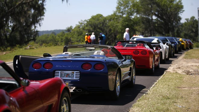 A line of Corvettes wait to be the first to take an inaugural ride on the Orchard Pond Parkway, the Florida's first privately built toll road, on Monday, April 18, 2016.