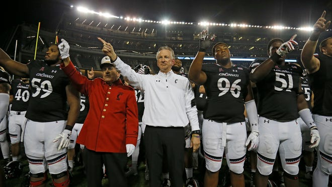 UC head coach Tommy Tuberville and the Bearcats sing the UC alma mater after the loss.
