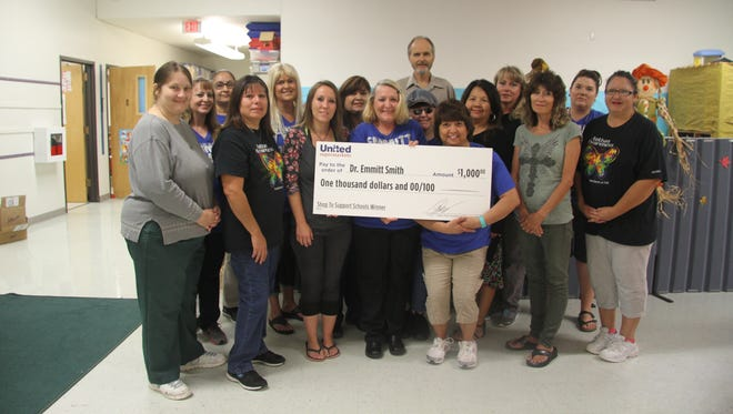 Emmitt Smith teachers and assistants were awarded a $1,000 donation by Albertsons in Carlsbad.