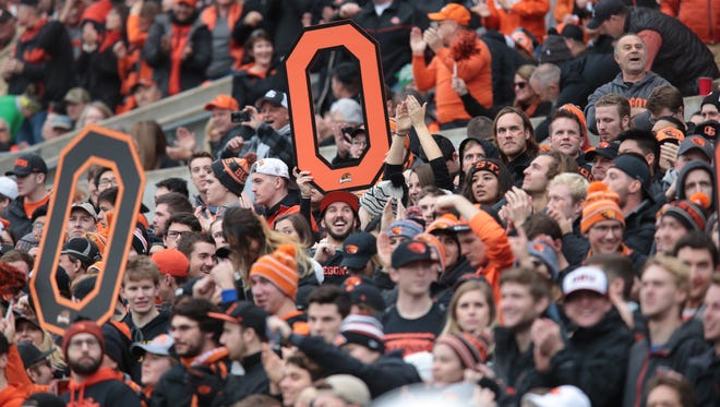 Nov 26, 2016; Corvallis, OR, USA; Oregon State Beavers fans celebrate a touchdown in the first quarter against the Oregon Ducks at Reser Stadium. Mandatory Credit: Scott Olmos-USA TODAY Sports