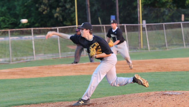 A Springfield Yellow Jacket pitcher throws at home.