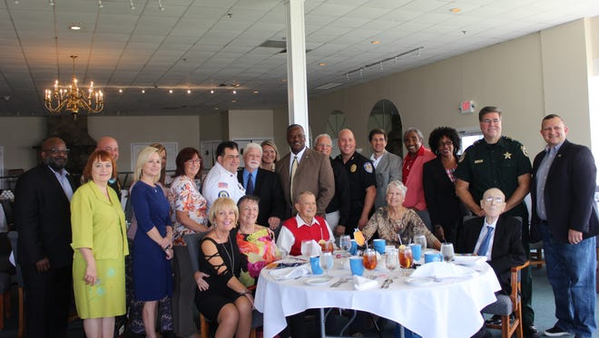 Standing, from left, are Boys and Girls Clubs of St. Lucie County CEO Will Armstead, Maureen Saltzer, Richard DelToro, Leslie Kristoff, Anita Fisher, Linda Bartz, Nate Spera, Jack Kelly, Michelle Franklin, Rep. Larry Lee, Charles Cangianelli, Frank Amandro, Tod Mowery, Kenneth Mills, Dr. Donna Mills, Sheriff Ken Mascara, and Jeremiah Johnson.Seated: Dee Bowman, Linda Dusanek, Chuck Hill, Betty Hill and Dr. William Dannahower.