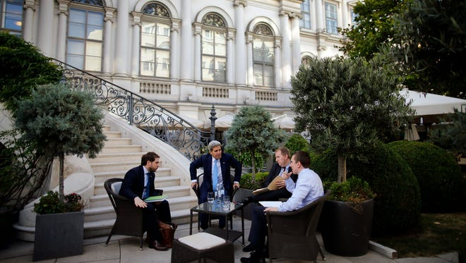 U.S. Secretary of State John Kerry, center, and State Department Chief of Staff Jon Finer, left, meet with other members of the U.S. delegation at the garden of the Palais Coburg hotel where the Iran nuclear talks meetings are being held in Vienna on July 10, 2015.