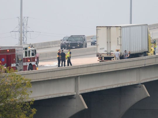 The southbound lanes of I-43 are closed over the Leo Frigo Bridge as workers clean up a fuel spill following a crash,Thursday, October 2, 2014.