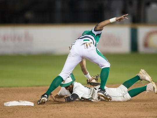 Bishop's Geno Huizar is tagged out as by Banquete's Christian Garcia slides in to second during the sixth inning of their game at Whataburger Field on Wednesday, March 21, 2018.
