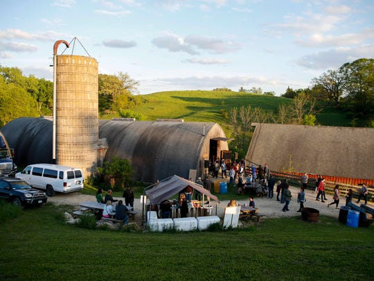 People quickly filled up the Codfish Hollow barn in rural Maquoketa to hear the bands Harriet and Edward Sharpe and the Magnetic Zeros on Tuesday, May 17, 2016.