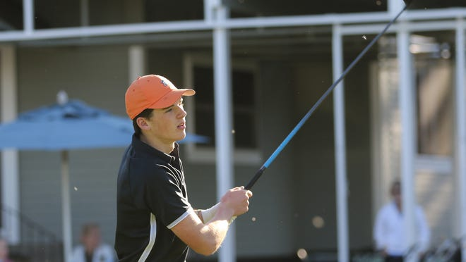 Wayland senior Joe Tardif watched his shot on the first tee during the match against Bedford at the Wayland Country Club on Thursday.