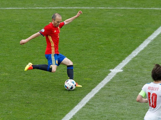 Spain's Andres Iniesta passes the ball during the Euro 2016 Group D soccer match between Spain and the Czech Republic at the Stadium municipal in Toulouse, France, Monday, June 13, 2016. (AP Photo/Hassan Ammar)