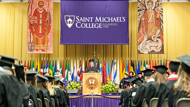 St. Michael's College student Michael McCarthy delivers the senior address during commencement ceremonies in Ross Sports Center on Sunday, May 14, 2017, on the school's campus in Colchester.
