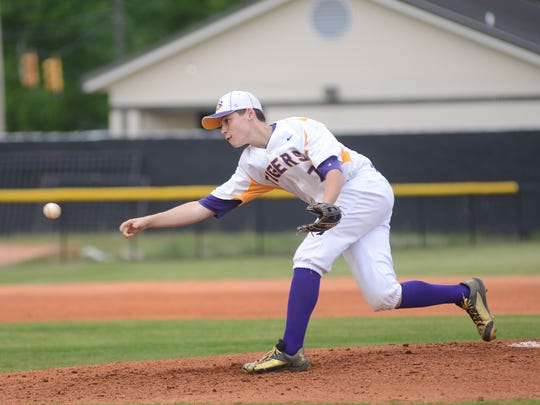 Hattiesburg's Noah Thornton sends a pitch to home plate