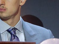 Phoenix Suns player Alex Len listens for the Suns position in the NBA Draft during the 2015 NBA draft lottery, Tuesday, May 19, 2015, in New York.