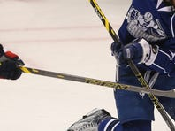 Rochester's Justin Bailey is driven into the net by Syracuse's Matt Taormina as goalie Kristers Gudlevskis moves gets out of the way during their game Monday, Jan. 18, 2016 at the Blue Cross Arena.